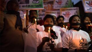 Indian activists mark the second anniversary of the fatal gang-rape of a student in Delhi on December 16, 2014.