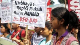 Socialist Unity Centre of India activists hold placards during a protest demanding death penalty for convicted gang-rapist, in Calcutta, 4 March