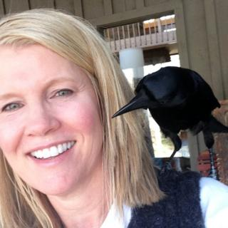 Lynn Witte with crow Sheryl perched on her shoulder