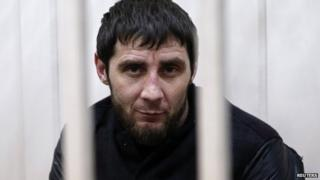 Zaur Dadayev, charged with involvement in the murder of Russian opposition figure Boris Nemtsov, looks out from a defendants' cage inside a court building in Moscow, 8 March 2015.