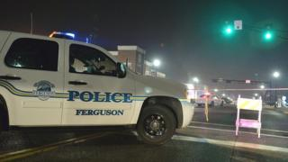 Police block off an area in Ferguson after two officers were shot.