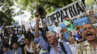 Demonstrators take part in a march against the construction of an inter-oceanic canal in Managua on 10 December, 2014