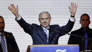 Israeli PM Benjamin Netanyahu (centre) waves to his supporters in Tel Aviv