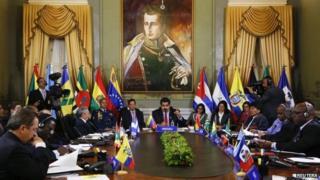 Venezuela's President Nicolas Maduro (centre) and Alba representatives speak during an Alba alliance summit in Caracas on 17 March, 2015.