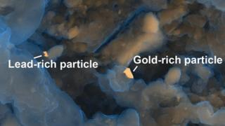 Gold and lead rich particles in human waste
