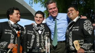 Governor Jeb Bush greets Mexican International Mariachi band members (L-R) Darwin Araujo, Alfredo Rojas and Douglas Cordero during a 'Florida - Mexico Cinco de Mayo Celebration: an Exchange of Cultures,' 5 May 2004