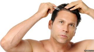Man plucking hair