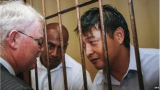 Myuran Sukumaran (centre) and Andrew Chan (right) in jail in Indonesia