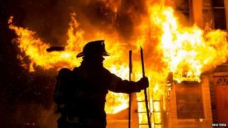 Baltimore fire-fighters battle a blaze in west Baltimore on Monday