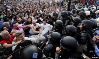 Protesters confront police outside government buildings in Skopje (5 May)