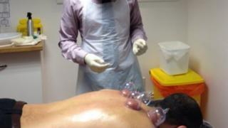 Dr Suleman with a patient