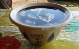 sky reflected in a cup of Ethiopian coffee