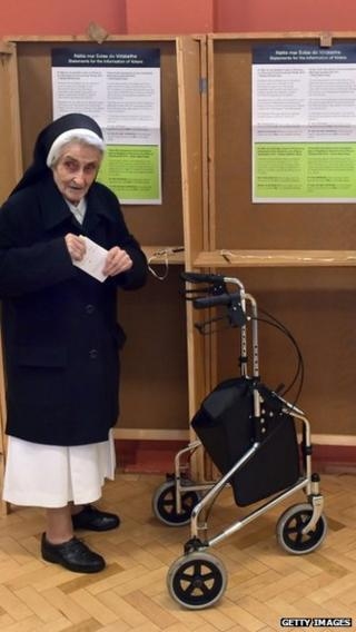 A nun casts her vote at a polling station in Dublin