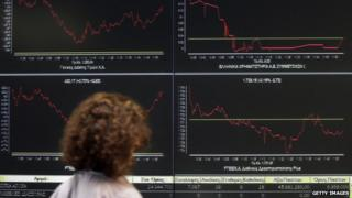Screens displaying share prices in Greece