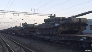Tanks are seen on a freight train shortly after its arrival at a railway station in the Russian southern town of Matveev Kurgan, near the Russian-Ukrainian border in Rostov region, on 26 May 2015.