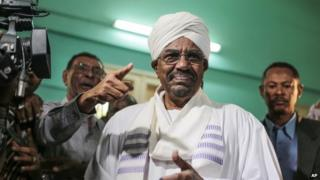 President Omar al-Bashir prepares to cast his ballot as he runs for another term in Khartoum, Sudan, 13 April 2015