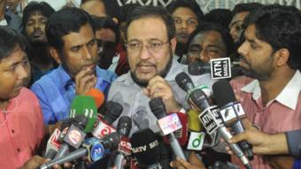 Abdulahail Amaan Azmi speaking to reporters after the death of his father in October 2014