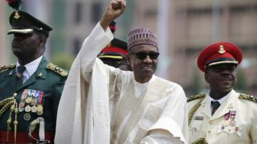 New Nigerian President, Muhammadu Buhari, salutes his supporters during his Inauguration in Abuja, Nigeria, Friday, May 29,