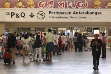 Passengers queue up for the security checks at the 2nd Kuala Lumpur International Airport in Sepang, Malaysia, 14 February