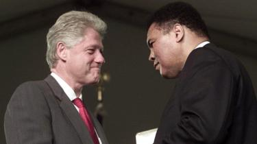 US President Bill Clinton presents boxing legend Muhammad Ali with the Presidential Citizens Medal during ceremonies 08 January 2001 at the White House