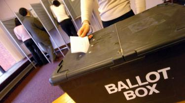 A polling booth and ballot box