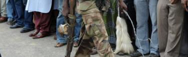 A Nigerian soldier with a whip - 2010