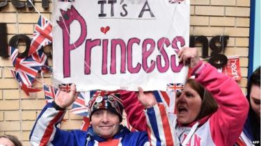 Royal fans celebrate outside St Mary's Hospital