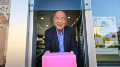 Ted Ngoy with a classic pink donut box