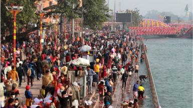 Hindu devotees on the banks of the river Ganges at Haridwar on 14 January