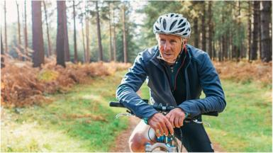 Pensioner on bike in forest