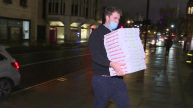 Pizza man delivering to trade talks