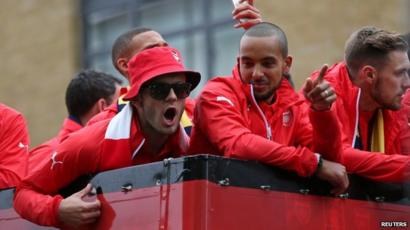 Arsenal's Jack Wilshere and Theo Walcott celebrate