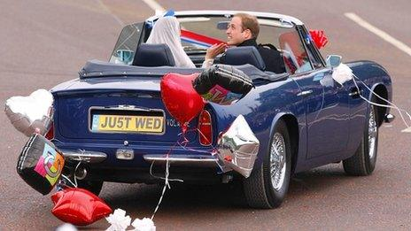 William and Kate leave Buckingham Palace in Prince Charles' vintage Aston Martin.