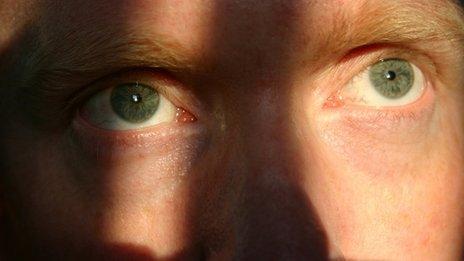 Man's eyes staring