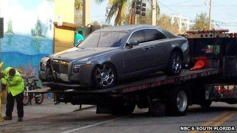 Damaged car on car transporter