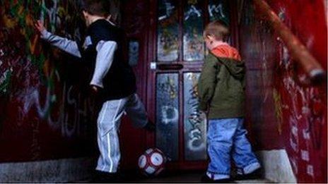 Boys play football in doorway