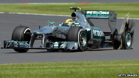 Lewis Hamilton's car suffers a blown tyre