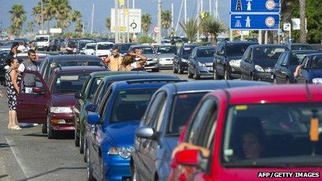 Motorists queue to cross the border between Spain and Gibraltar