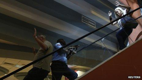 A policeman secures the Westgate shopping centre