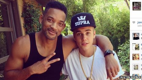 Justin Bieber posing with Will Smith