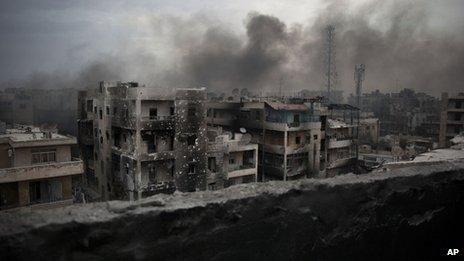 Smoke rises over Saif Al Dawla district, in Aleppo, Syria