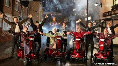 One Direction with elderly women on mobility scooters