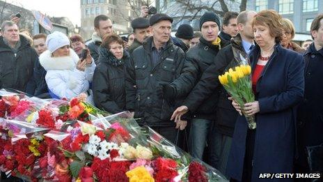 Catherine Ashton lays flowers at a tribute in Ukraine
