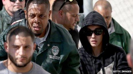 Justin Bieber (R) exits from the Turner Guilford Knight Correctional Centre on January 23, 2014