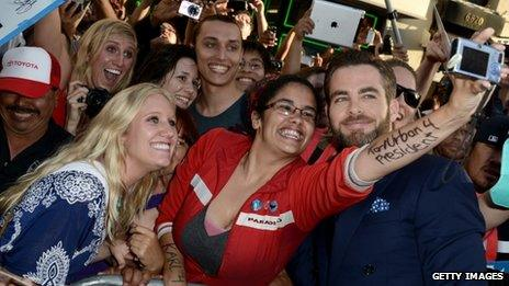 Chris Pine poses with fans