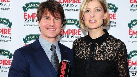 Tom Cruise with his Legend in Our Lifetime award, presented by Rosamund Pike