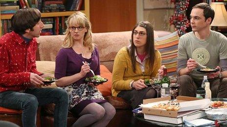 The cast of The Big Bang Theory eating on a sofa
