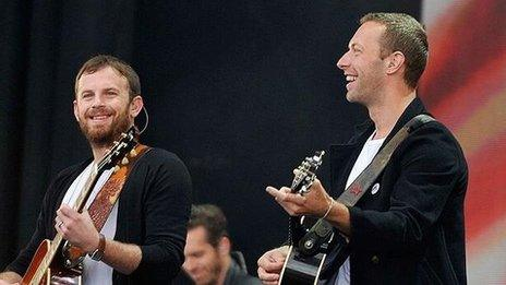 Kings of Leon and Chris Martin on stage