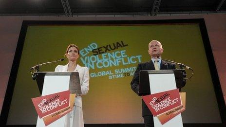 Britain's Foreign Secretary William Hague and US actress and UN special envoy Angelina Jolie make their opening speeches at the four-day Global Summit to End Sexual Violence in Conflict in east London on 10 June 2014.