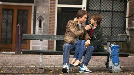 The lead characters of The Fault in Our Stars on a bench